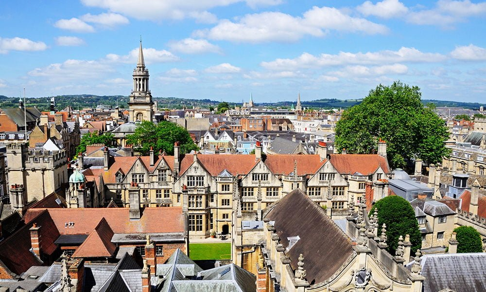 View over the city rooftops from the University church of St Mary spire, Oxford, Oxfordshire, England, UK, Western Europe.